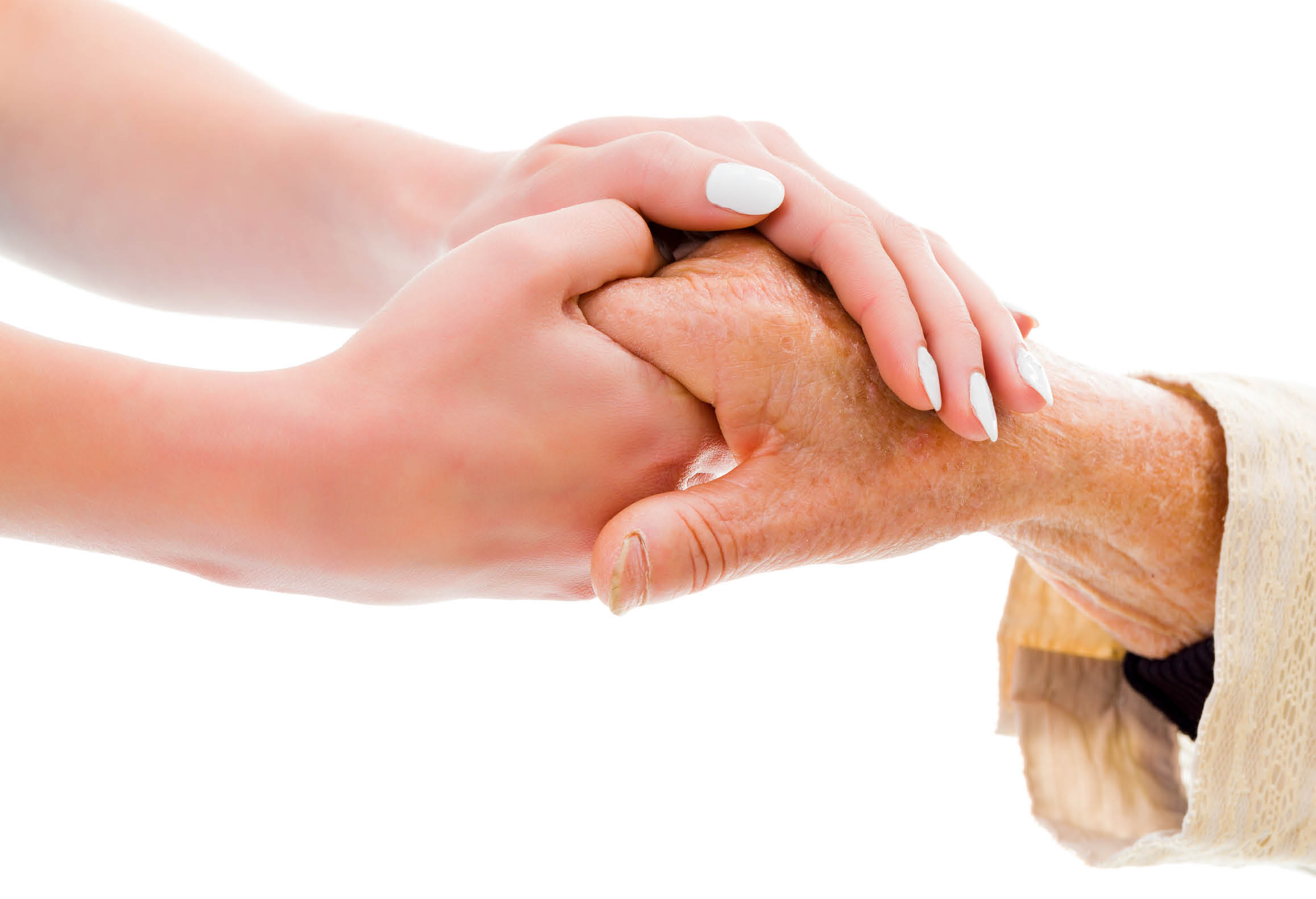 Yngre person håller handen på äldre person